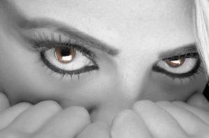 woman's eyes looking afraid
